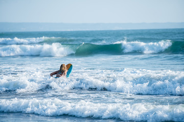 Surfing the waves of Indonesia beach