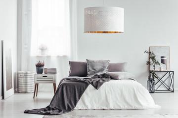 White lamp in bright bedroom