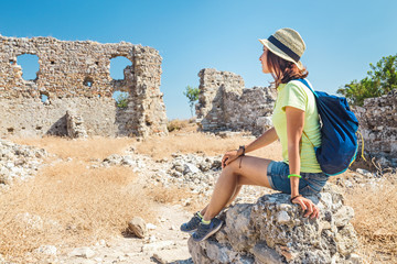 Happy woman tourist travels in famous ancient town, historical and archeology concept