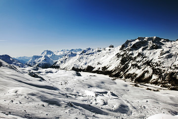 An amazing view of the mountains and snow covered landscape and town in the alps switzerland in winter