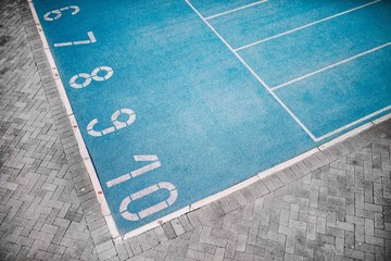 Photo of blue running track with numbers
