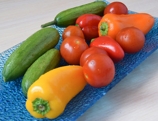 Aluminium Prints Grocery Green cucmbers, red and orange pepper, cherry tomatoes