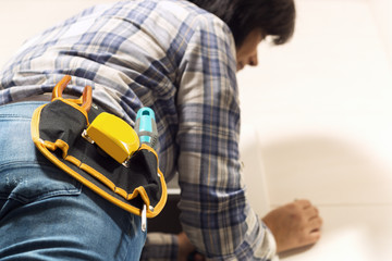 electrician woman installing heater