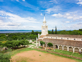 "Aerial view of the catholic church ""Iglesia Virgen de la Candelaria"" of Aregua in Paraguay overlooking Lake Ypacarai"