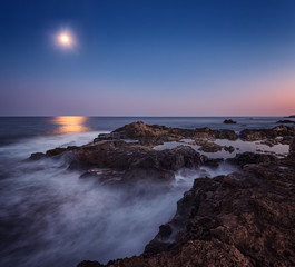 On the moonlight / Long time exposure night landscape with full moon above the rocky Black sea coast