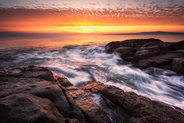 Dawn above the rocks / Sea sunrise at the rocky Black Sea coast near Sozopol, Bulgaria