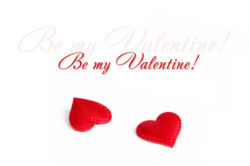 Valentine's day concept / Red textile hearts on a white background