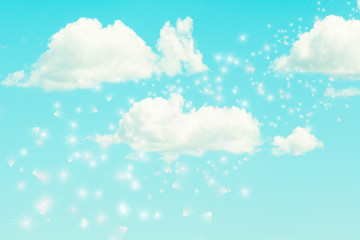 metaphysical cloudy turquoise sky with white soft clouds and dandelion seeds