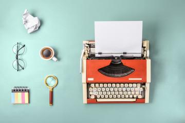 Red typewriter and fresh coffee (flat lay)
