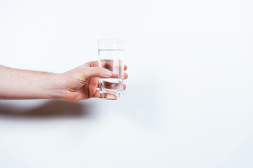 Man holding glass of water.