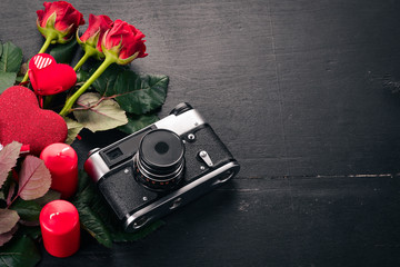 Valentines day. Roses, camera, gift. Love. Top view. Free space for your text.