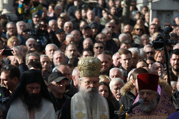 Clergymen are seen during the funeral of Oliver Ivanovic in Belgrade