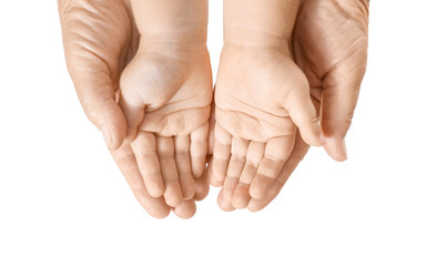 Hands of elderly man and baby on white background