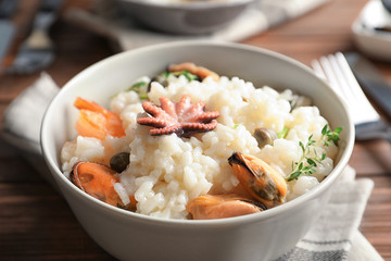 Dish with delicious seafood risotto on table, closeup