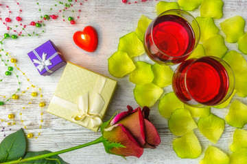 Valentine's composition of colorful decorations, a preview of a romantic dinner with wine