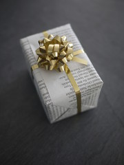 present  wrapped newspaper instead
