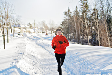 Woman Running in Snowy Park