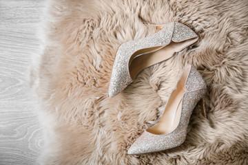 Beautiful high heeled shoes on furry rug Wall mural