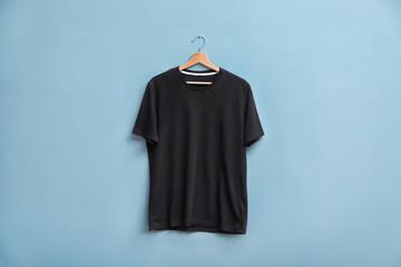 Black t-shirt on color background. Mockup for design