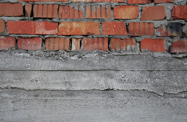 Red brick wall with plaster
