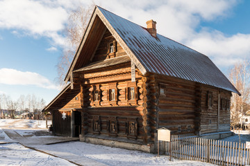 Ancient wooden Russian hut in winter. Old wooden house in Russia. Museum of wooden architecture in Suzdal. Suzdal. The house of a prosperous peasant of the XIX century.
