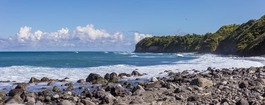 Panoramic view of rocky beach and sea cliffs on St Kitts
