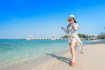 Wall Mural - Young woman walking on beach in Si chang island, Thailand.