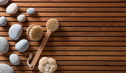pebbles set on Turkish bath wooden board with body brushes