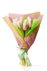 Bouquet of tender pink tulips wrapped in paper and bandaged with ribbon. Isolated on white.