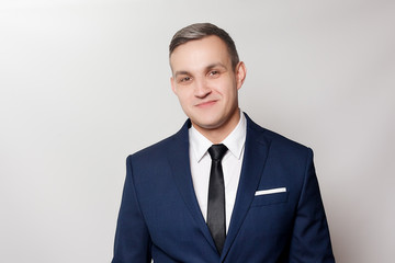 Portrait of handsome man in black blue suit