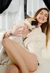 beautiful young happy woman with dog