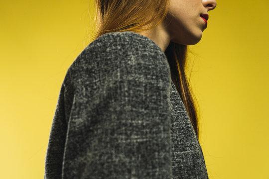 Woman in gray jacket