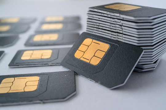 SIM cards for mobile phones in one stack leaning against the stack
