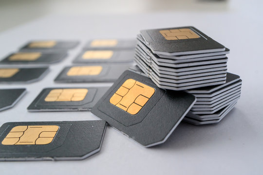 gray SIM card for phones collected in a column, next are cards