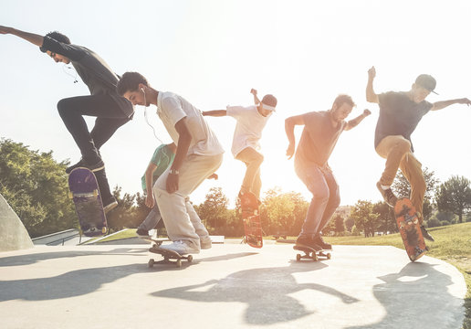 Skaters jumping with skateboard in city suburb park