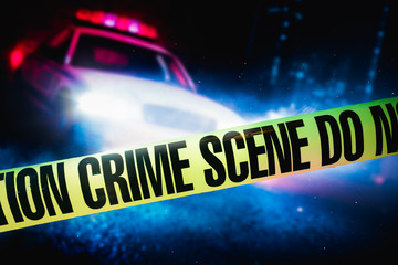 police car at a crime scene with police tape, high contrast image
