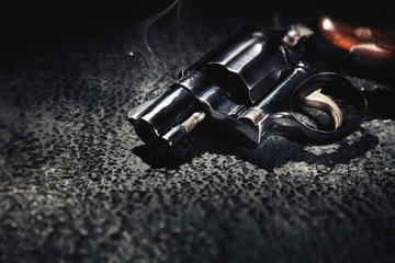 Smoking gun on the floor, high contrast image