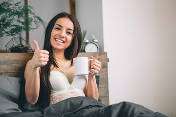 Good morning Woman woke up in bed. Woman drinking coffee in bed