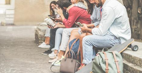 Group of millennials friends using smartphones  outdoor
