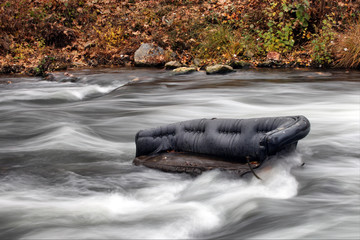big black couch in the river