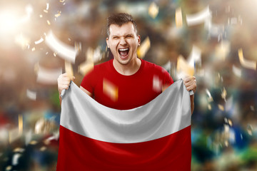 Polish fan, a fan of a man holding the national flag of Poland in his hands. Soccer fan in the stadium. Mixed media
