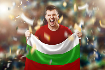 Bulgarian fan, fan of a man holding the national flag of Bulgaria in his hands. Soccer fan in the stadium. Mixed media