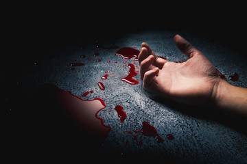 hand on a puddle of blood with dramatic lighting Wall mural