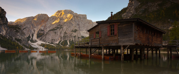 Woody house on the bank of the lake Lago di Braies, Dolomites, Italy