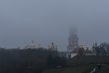 View of the Kiev Pechersk Lavra. Bell tower in a fog