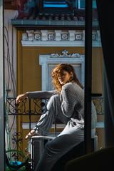 Young woman posing on balcony
