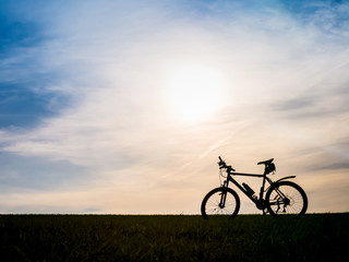 Bicycle silhouettes on the dark background of sunsets Wall mural