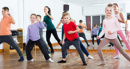 Young boys and girls studying contemp dance