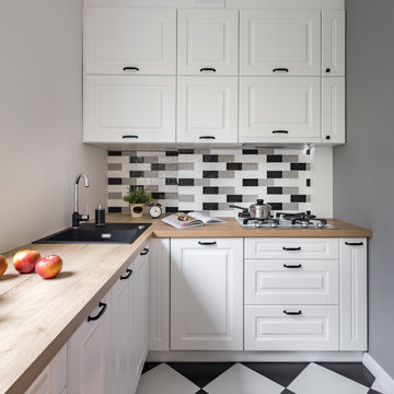 Small kitchen with white furniture