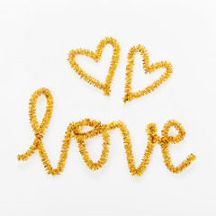 The word LOVE and Heart made of tinsel. Valentines day concept . Flat lay, top view